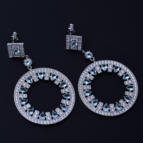 Round drop earrings with Light blue pear shapes