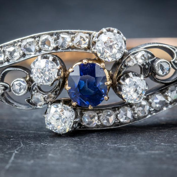 Flowing French Curves – A Sapphire Heart with an Entourage of Diamonds