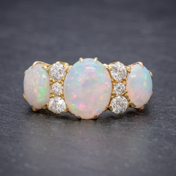 ANTIQUE VICTORIAN NATURAL 5CT OPAL TRILOGY RING 18CT GOLD CIRCA 1880 FRONT