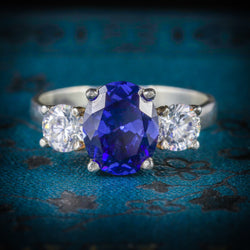 CZ TANZANITE AND PASTE TRILOGY RING COVER