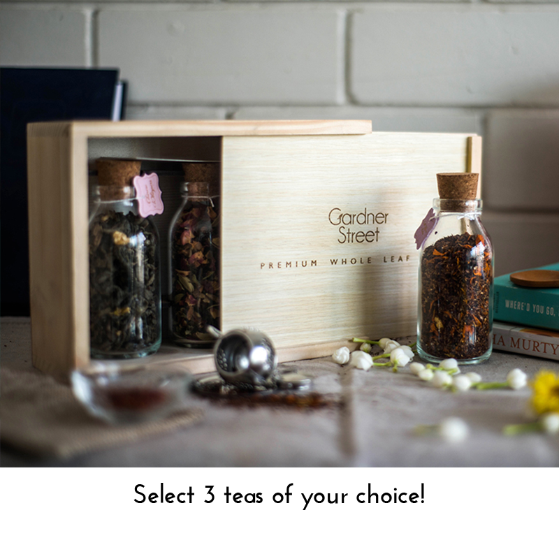 Rustic Pinewood Box with Glass Bottles