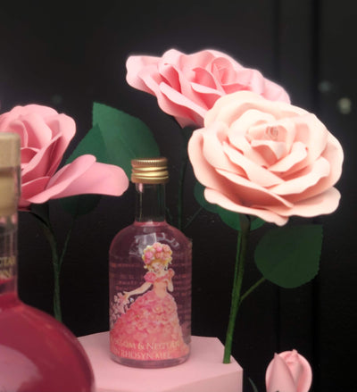 A Blossom & Nectar welsh honey and rose petal infused gin with hand painted artwork by local artist Rebecca Harry and handmade paper roses by Cartaandwood. Produced for Blossom & Nectar by Gower Gin. This is the 3rd in the hand made gin series all containing Blossom & Nectars raw welsh honey, as they are ethical natural beekeepers. Available to purchase via their website or their small shop in Pontcanna Cardiff, near where their beehives are based. showing 5cl