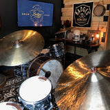 Drummers and gather, play, relax at Badges Drum Shop