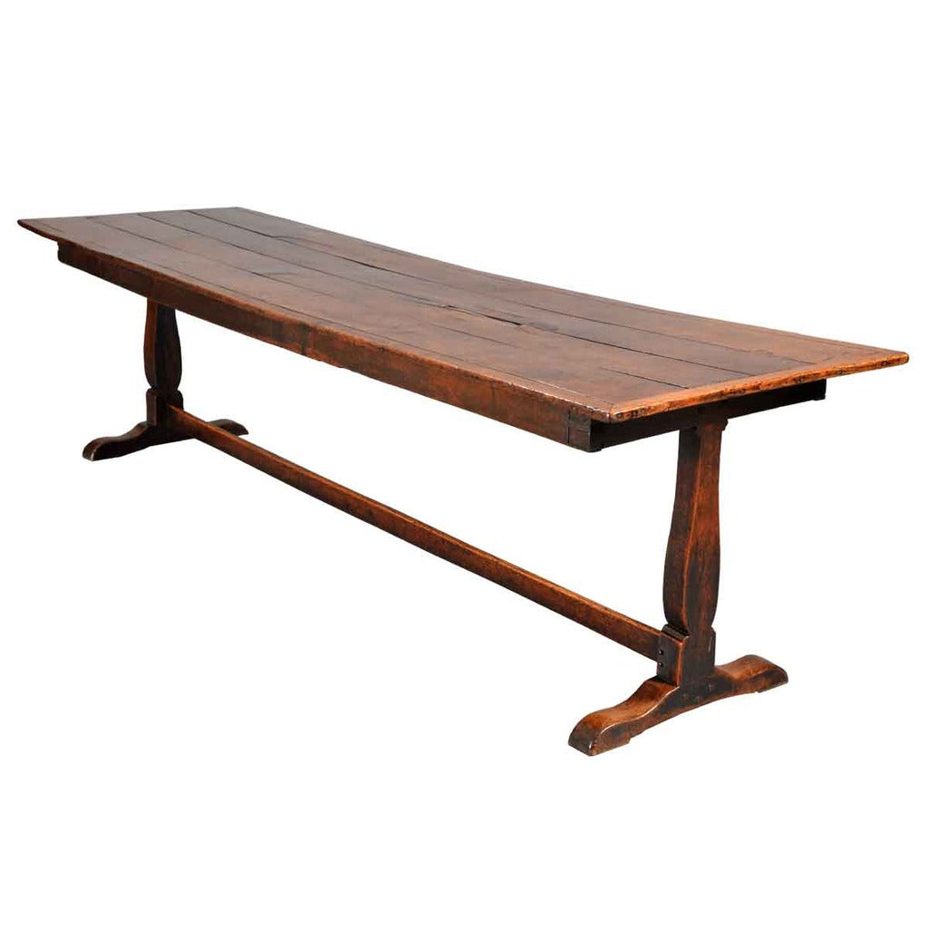 An Early 18th Century Farm Table On Trestle Base. View 1