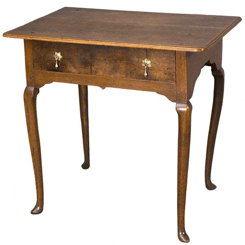 An antique 18th century English oak side table with a single drawer. view 1
