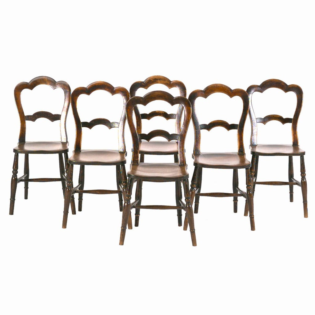 A set of six English country side chairs with shaped crest rail and cross splat. view 1