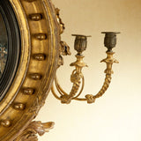 A large 19th century antique giltwood convex mirror of extraordinary quality. view 3