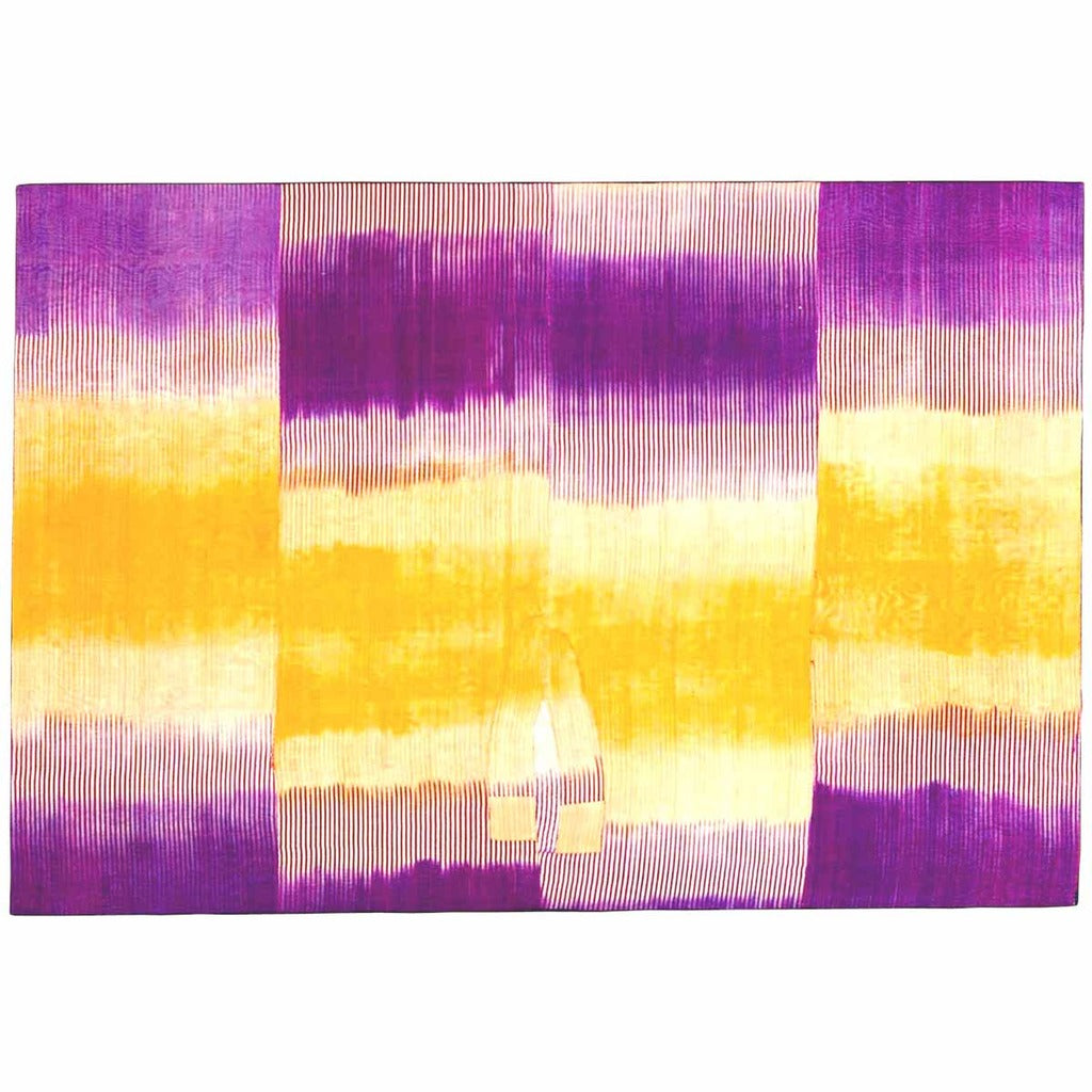 An Uzbek ikat in silk with striking purple and gold pattern from 19th century. view 1