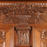 A highly carved 19th century oak armoire. view 3