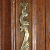 A highly carved 19th century oak armoire. view 2