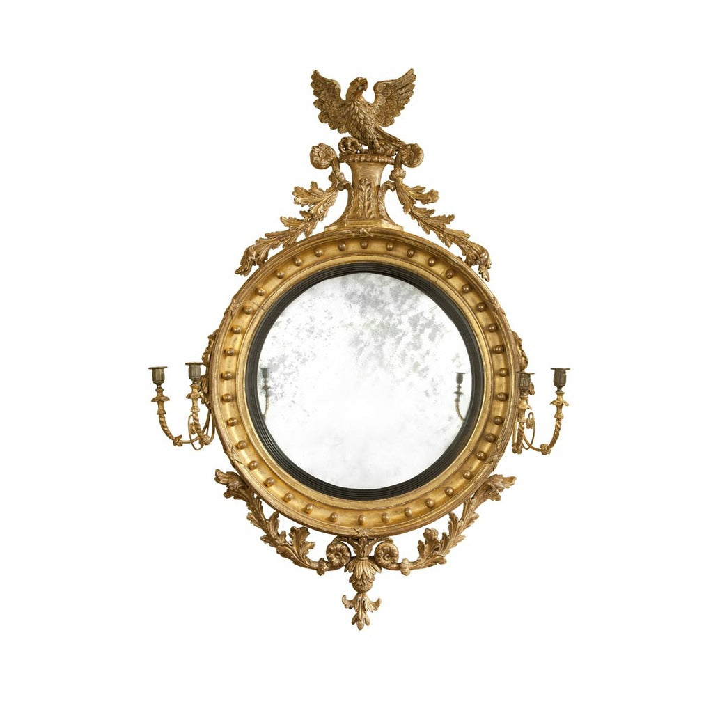 A large 19th century antique giltwood convex mirror of extraordinary quality. view 1