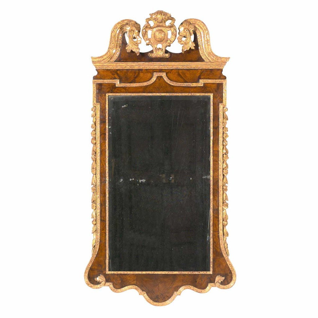 A large antique George III walnut and parcel gilt mirror with the original plate. view 1