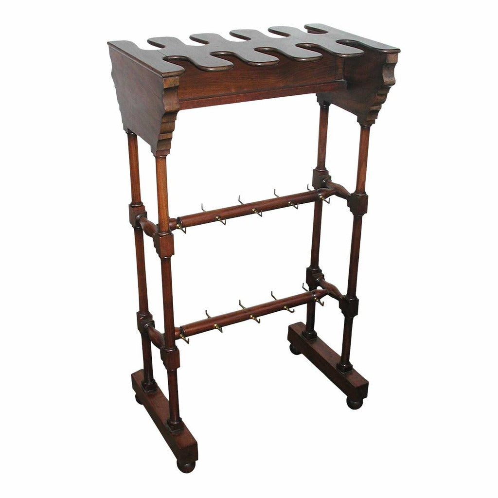 A 19th century English mahogany boot rack. view 1