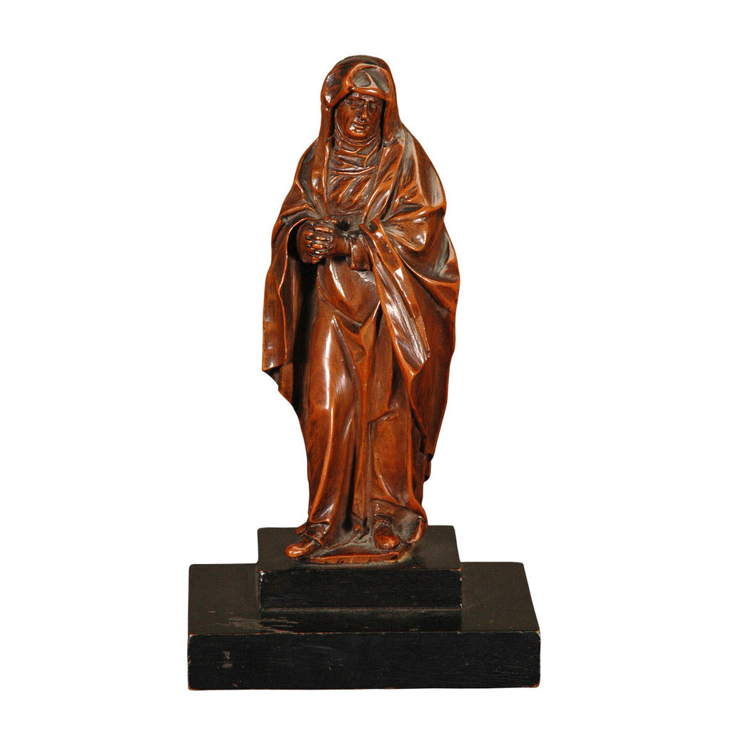 A 17th century Flemish boxwood carving of a robed figure. view 1