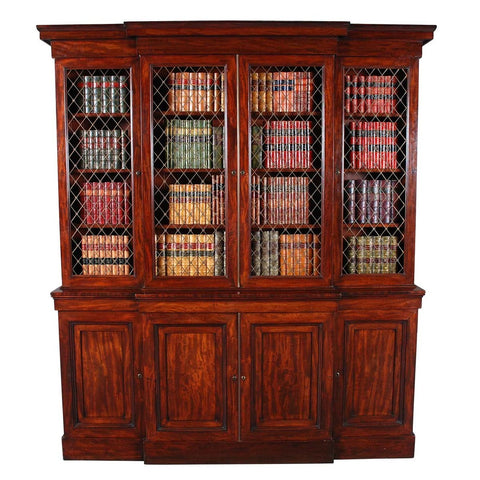 A Regency period breakfronted bookcase with brass grilled doors. view 1