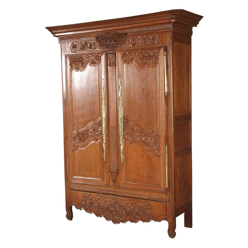 A highly carved 19th century oak armoire. view 1