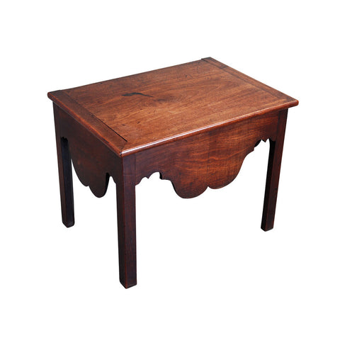An antique English mahogany close stool with hinged lid, shaped apron, cleated top. view 1