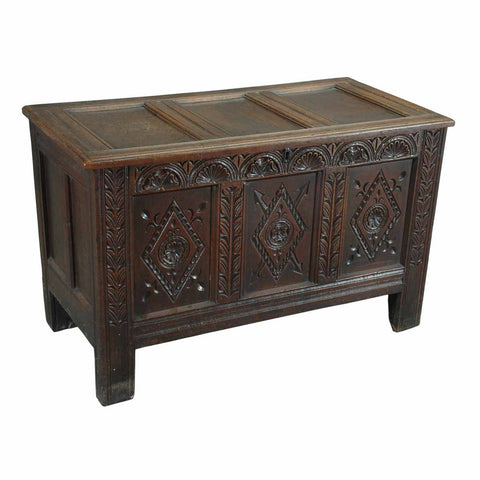 An English oak coffer with three diamond-carved panels across the front and paneled lid. view 1