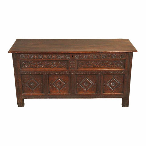 A 18th century highly carved oak coffer. view 1