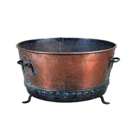 A 19th century round copper log bin of great size raised on iron feet and with iron handles. view 1