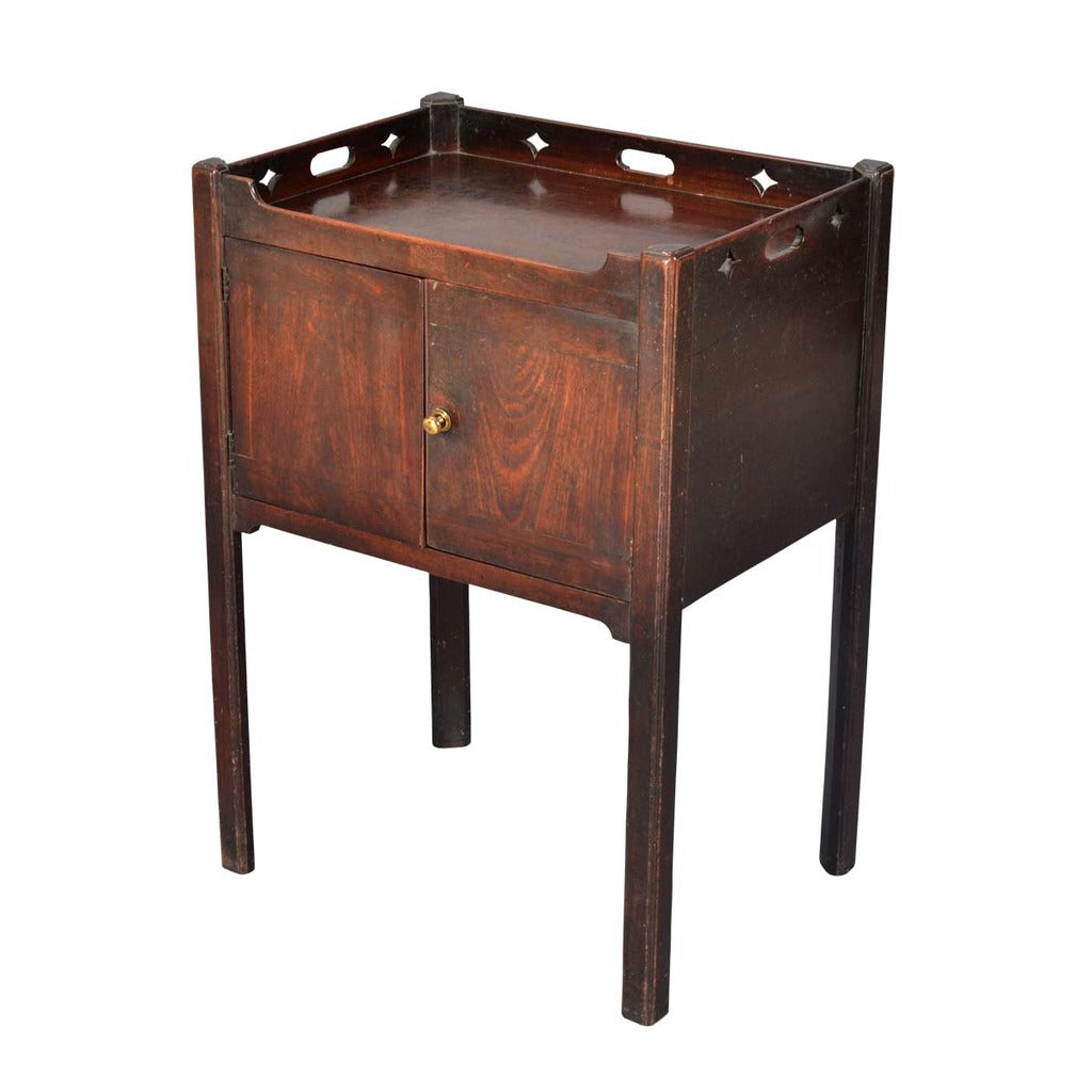 A 18th century mahogany two-door bedside cupboard. view 1