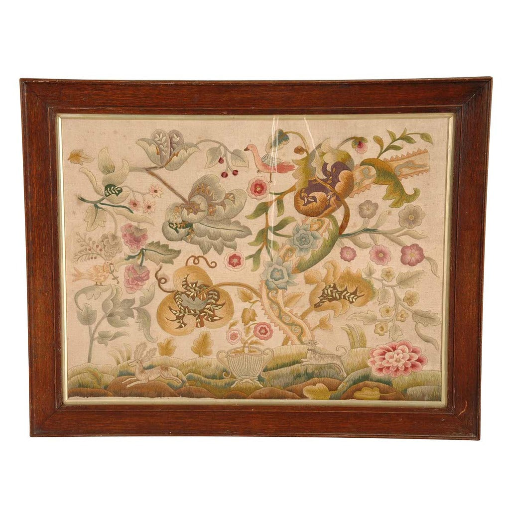 An 19th Century antique English crewel work panel in an oak frame. View 1