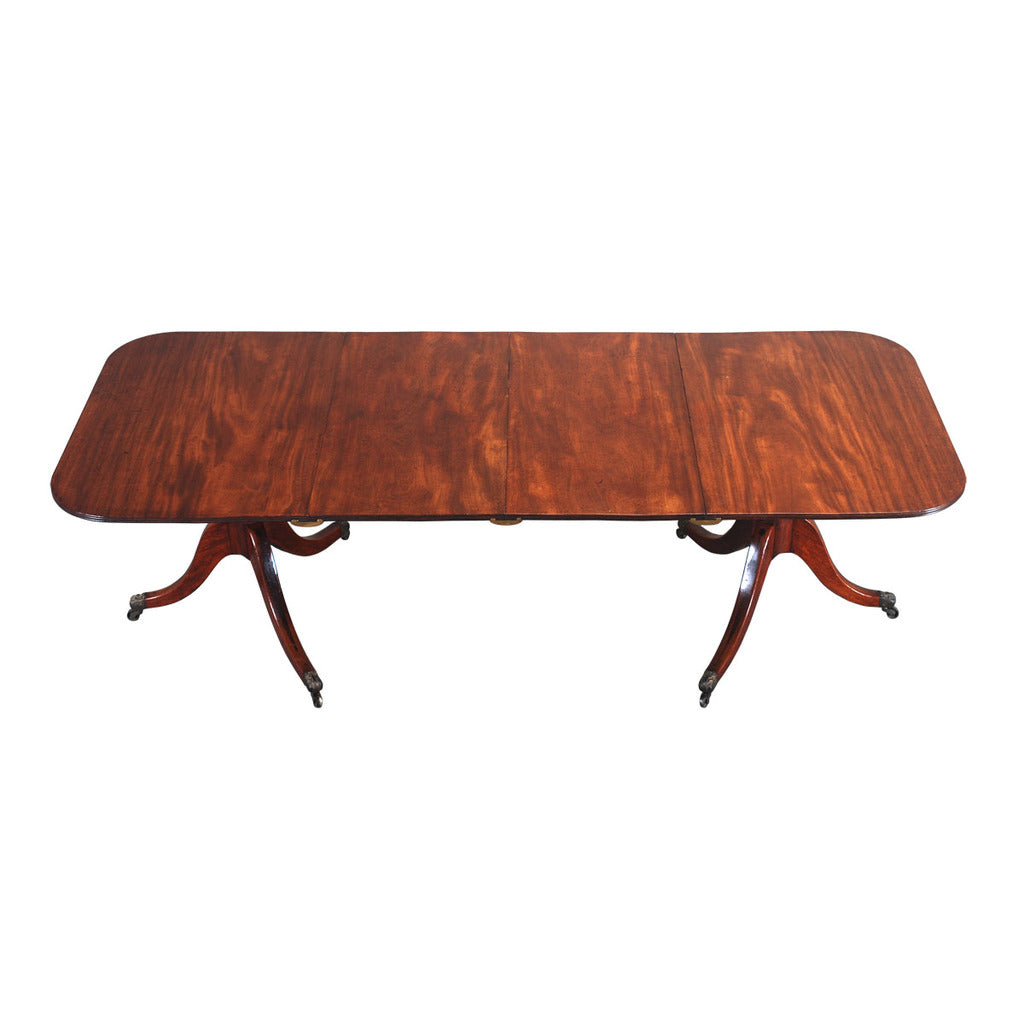 An English mahogany dining table with rounded rectangular top. view 1
