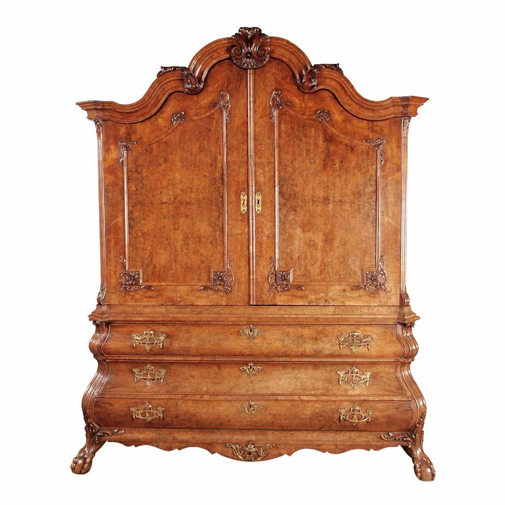 A 18th century burl walnut cabinet on bombe-shaped base. view 1