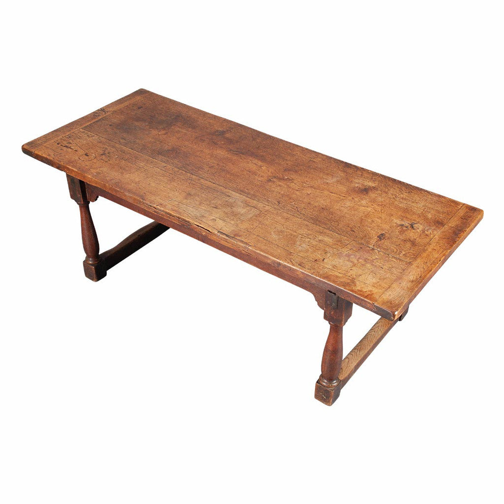 An oak farm table on turned legs