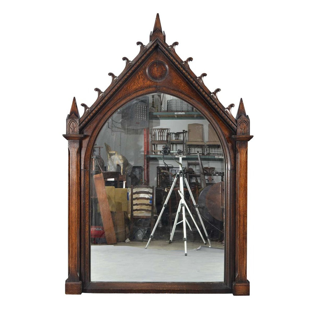 A 19th century large oak Gothic Revival frame from a French church now fitted with a mirror plate. view 1