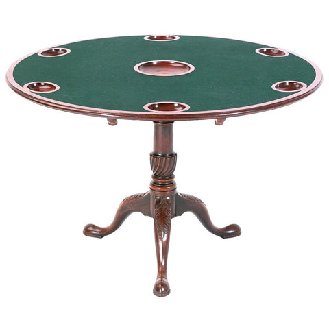 A mahogany games table with acanthus leaf-carved pedestal and money wells in the top. view 1