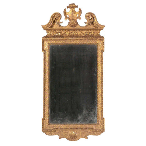 A 18th century George III architectural gilt mirror with swan neck pediment and shield cartouche. view 1