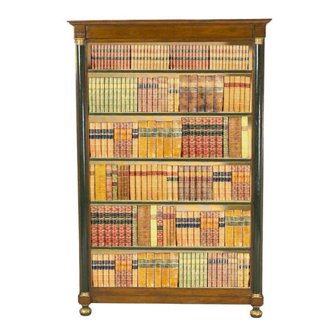 A 19th century Italian walnut bookcase with half-column pilasters. view 1