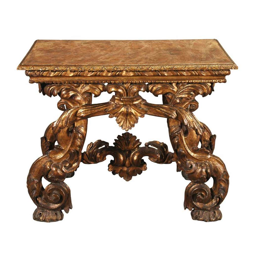 An Italian boldly carved giltwood console with C-scroll legs and painted faux-marble top. View 1