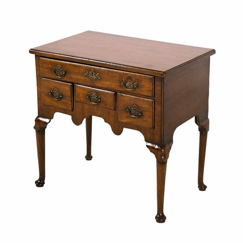 An English mahogany lowboy standing on modified cabriole legs ending in pad feet. view 1