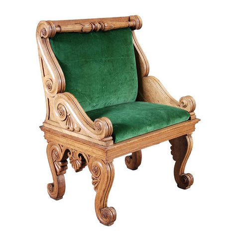 A 19th century late Regency oak hall chair carved extensively. view 1