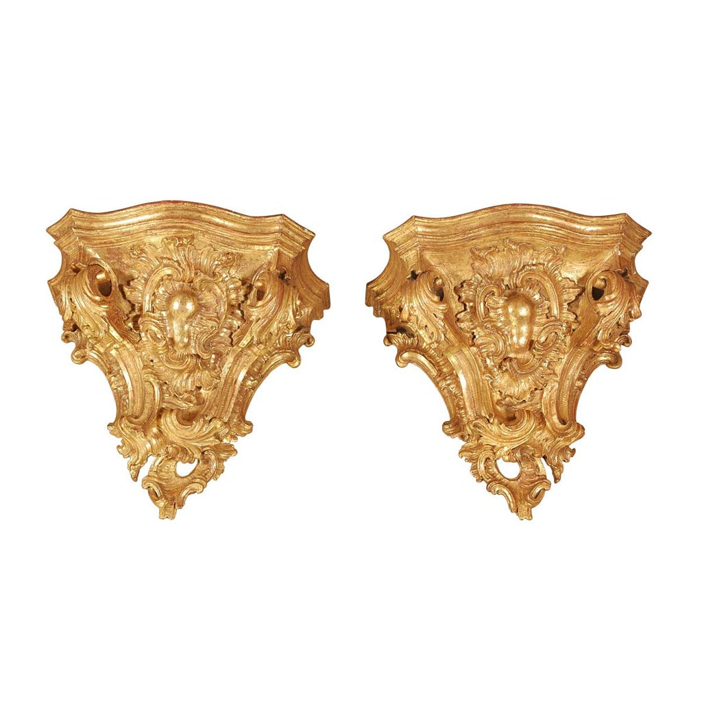 A pair of massive Italian gilt brackets from the 18th century. view 1