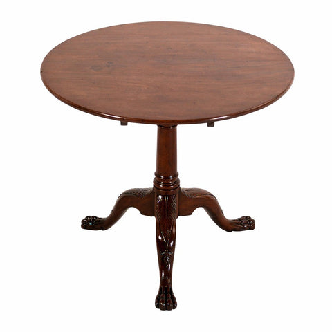An antique English mahogany tripod table with paw feet from 18th century. view 1