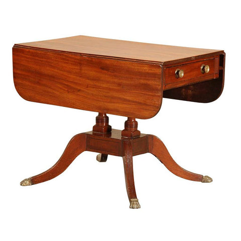 An antique mahogany pembroke table on carved twin pedestal base. With a single drawer. view 1