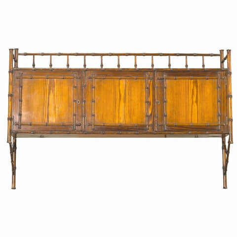 A 19th century English pitch pine hanging cabinet with simulated bamboo gallery. view 1
