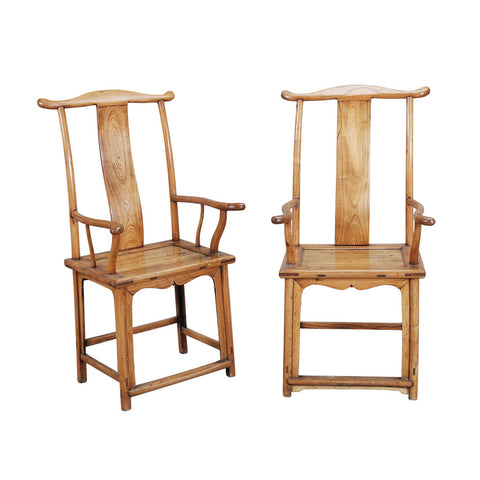 A pair of Chinese yoke-back armchairs of traditional form with well-shaped arms and crest-rail, undulating backsplat, and connecting stretchers. view 1