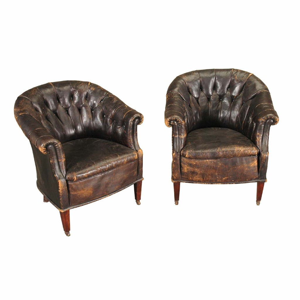 A 20th century pair of leather tub chairs. view 1 - Pair Of Leather Tub Chairs – Jayne Thompson Antiques Inc.