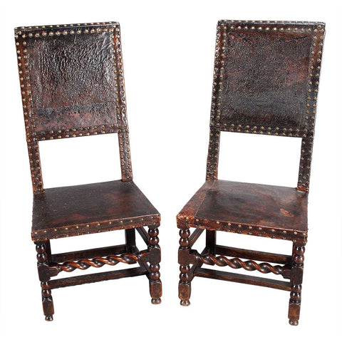 A Pair of Leather-Covered Hall Chairs