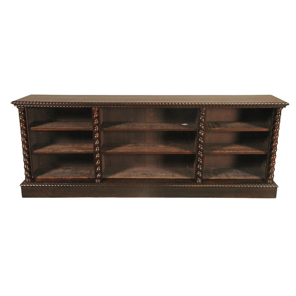 An English rosewood bookcase with barley twist columns separating the three sections. view 1