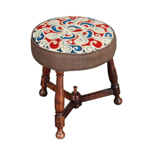 A 19th century round fruitwood stool on three turned legs connected by stretchers. view 1