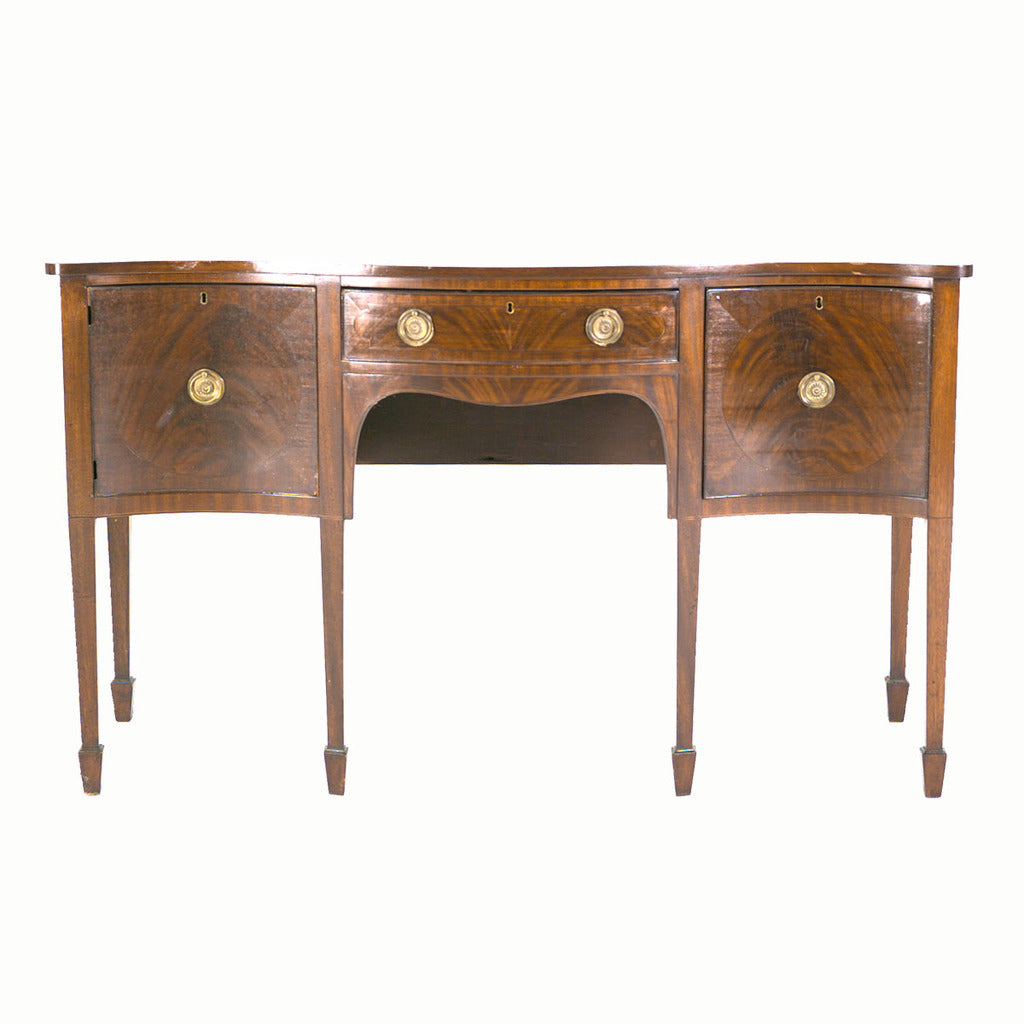 An English Sheraton period sideboard with serpentine shaped front. view 2