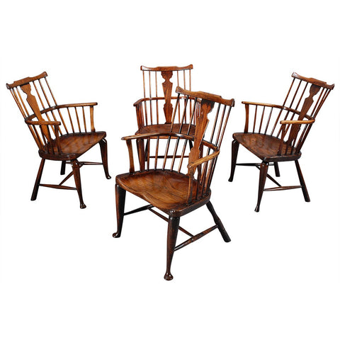 A Matched Set of Four Comb-Back Windsor Armchairs