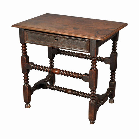 A 17th century English Charles II period oak side table. view 1