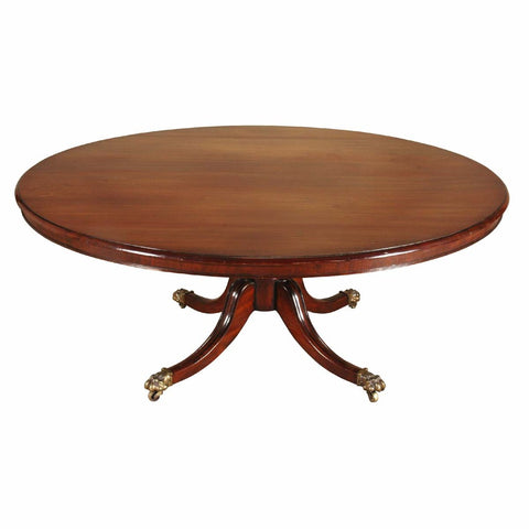 An English mahogany dining table on turned pedestal with four-splay legs. view 1