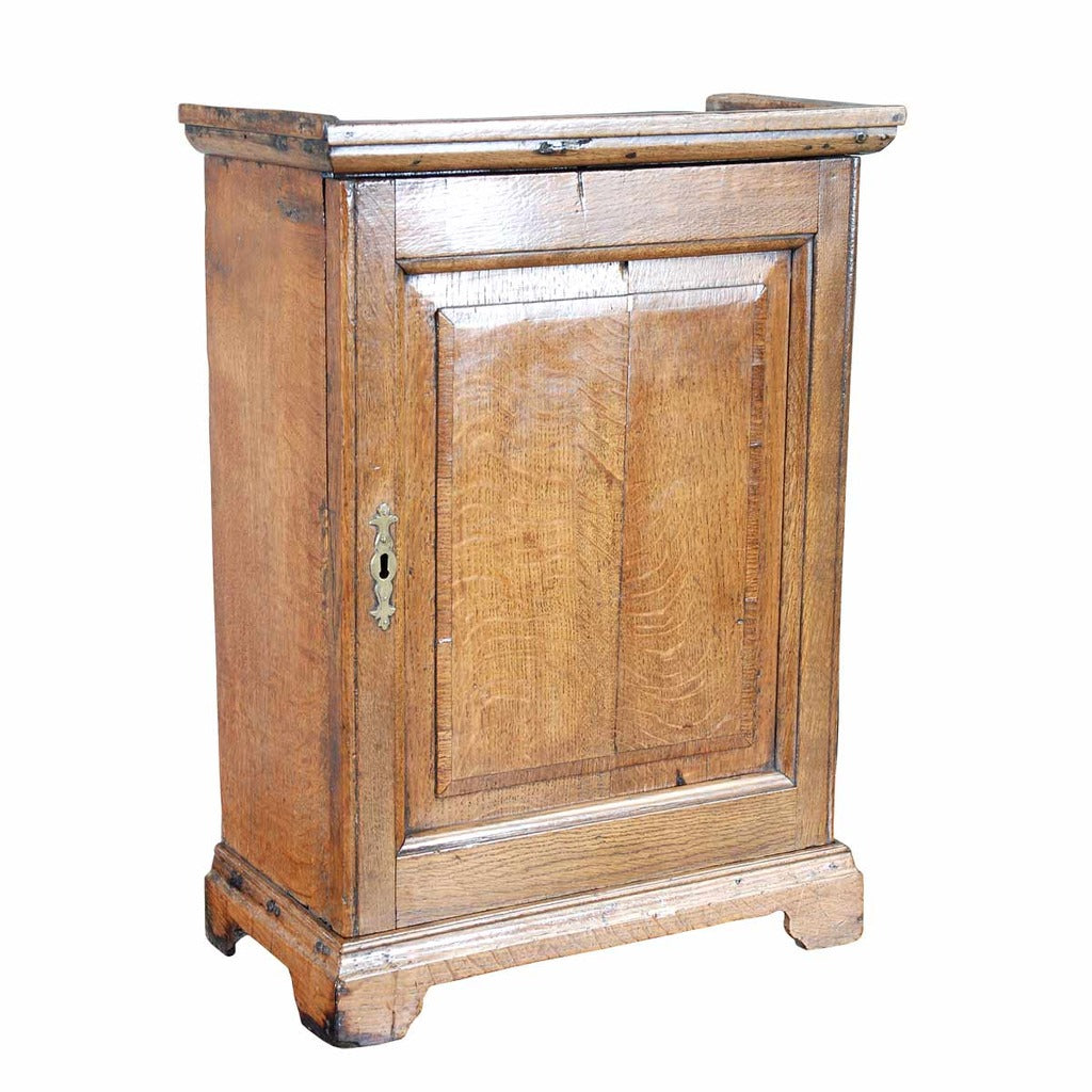 An 18th century English oak spice cupboard on bracket feet. view 1